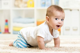 Cute baby learning to crawl