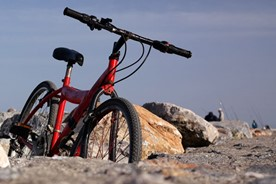 Bicycle parked on rough terrain