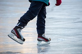 Ice skating on a pond