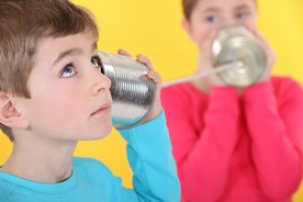 Old-fashioned tin can telephone