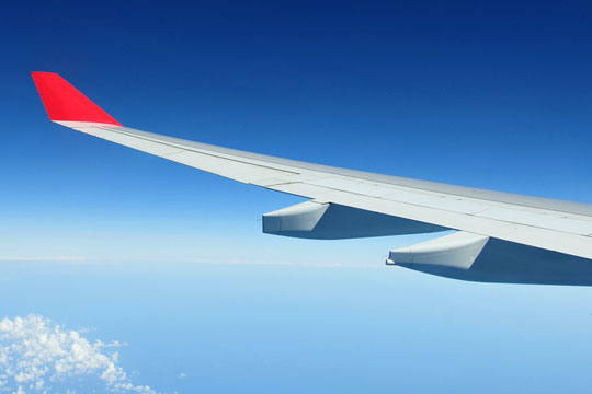 Airliner wing visible during a flight