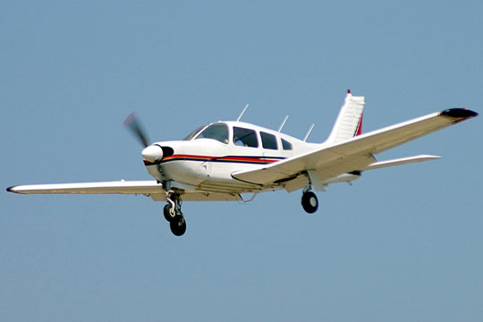Small aircraft preparing to land