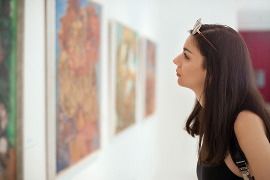 Inspecting pictures at an art gallery