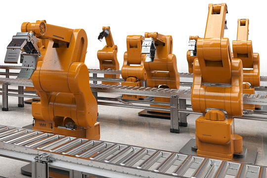 Orange robots on an automated assembly line