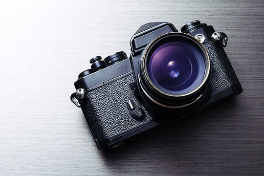 SLR camera with lens pointing forward