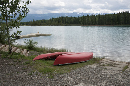 Canoe and kayak on a lake shore