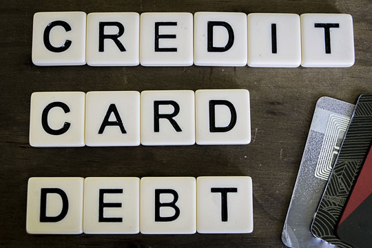 Credit card debt written on letter tiles