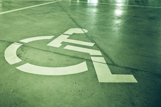 Disability symbol on a reserved parking space