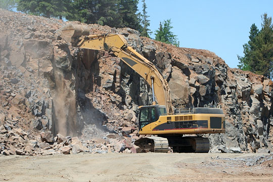 Equipment used to excavate a hillside