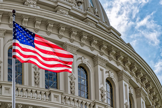 United States Capitol and American Flag