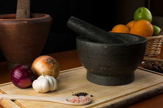 Food and pestle shown in a fine art painting