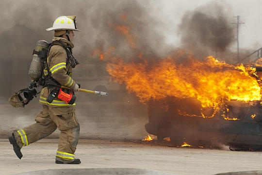 Firefighter working to extinguish a blaze