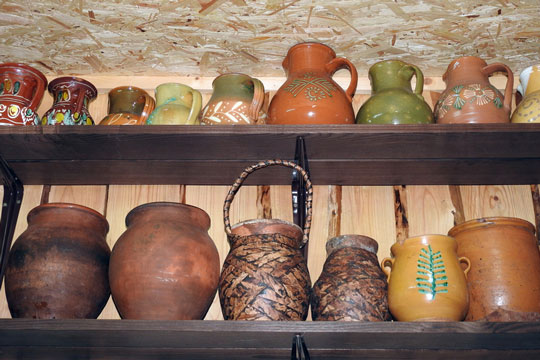 Two shelves of pottery housewares