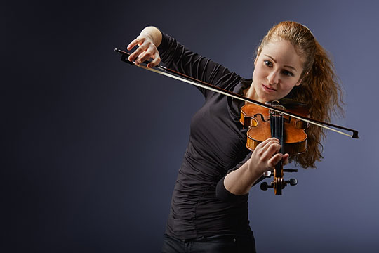 Musician playing her violin
