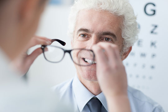 Optician dispensing eyeglasses