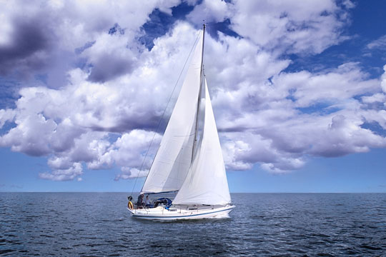 Sailing a boat on a partly cloudy day