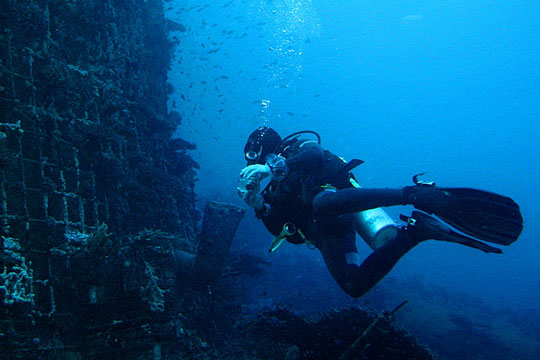 Diver wearing scuba diving equipment