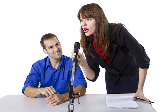 Hearing a woman speak in a microphone