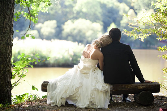 Bride and groom seated on a bench